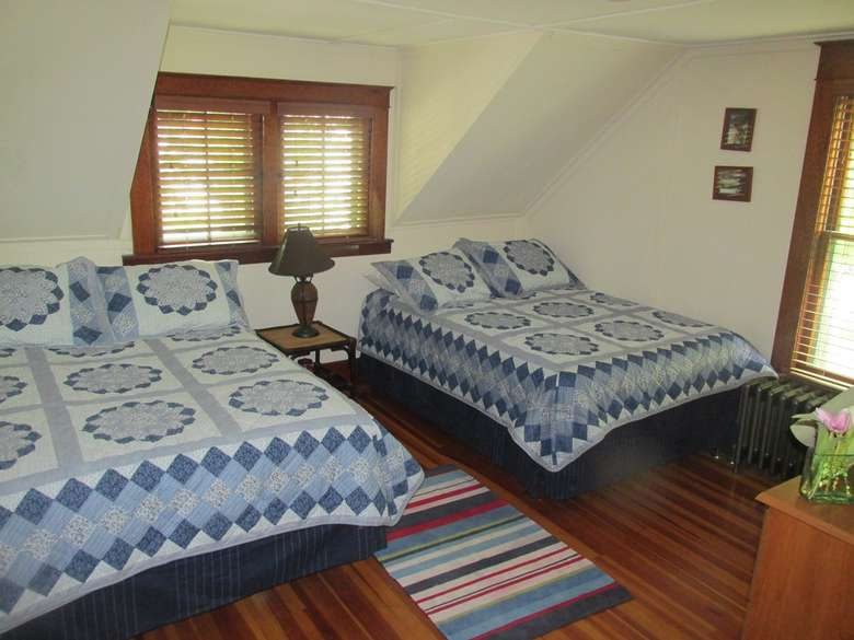 two beds side by side in a bedroom