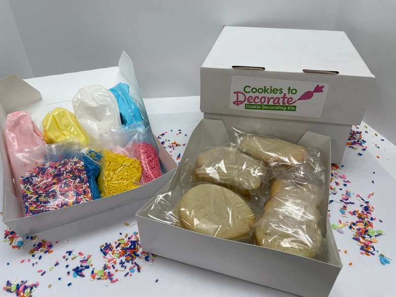 cookie decorating kits with sprinkles, frosting, and cookies