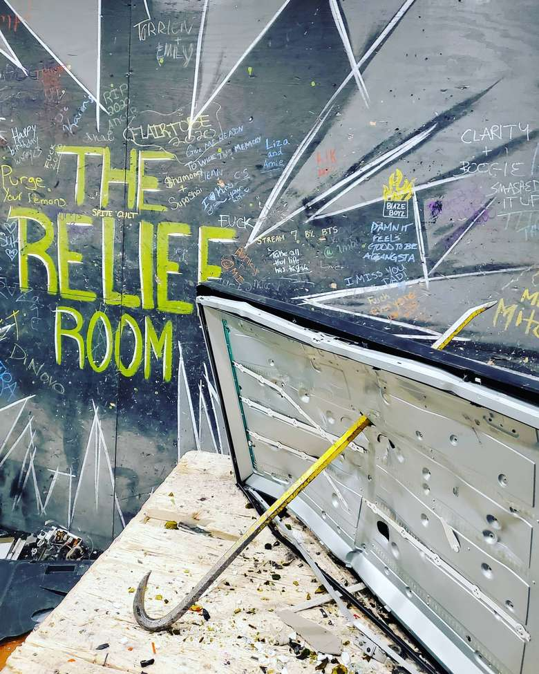 crowbar in room and wall with words that say the relief room