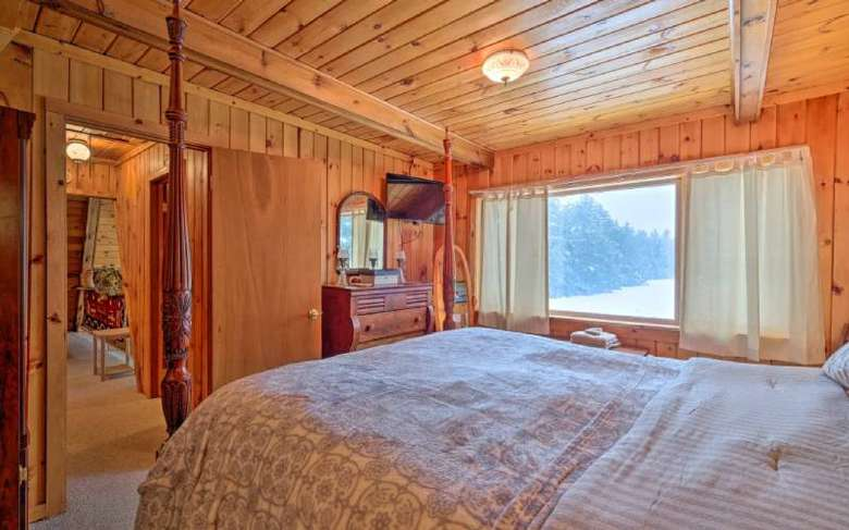 bedroom with wooden walls and one bed