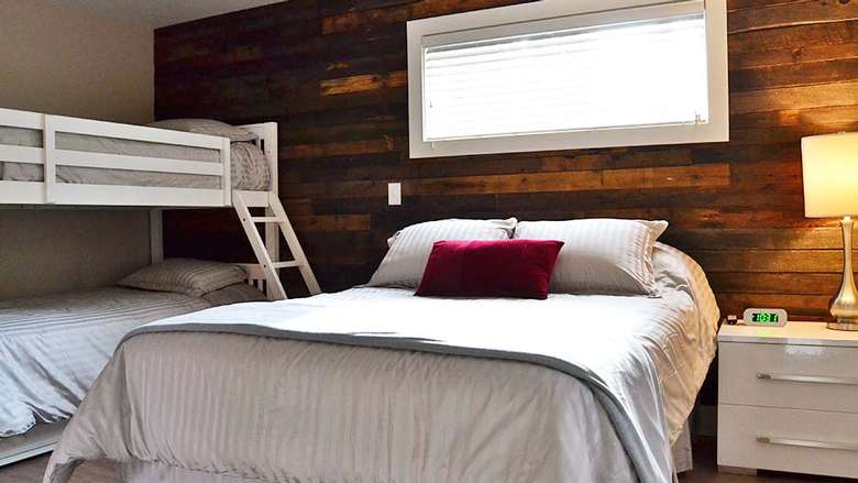a bed next to a bunk bed in a bedroom