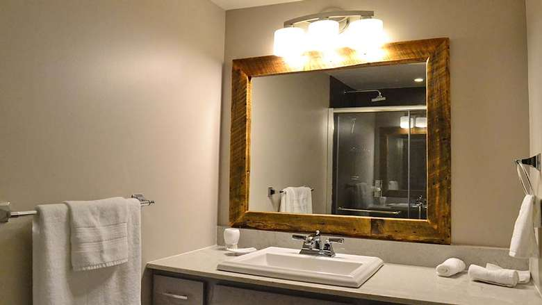 bathroom mirror above a sink