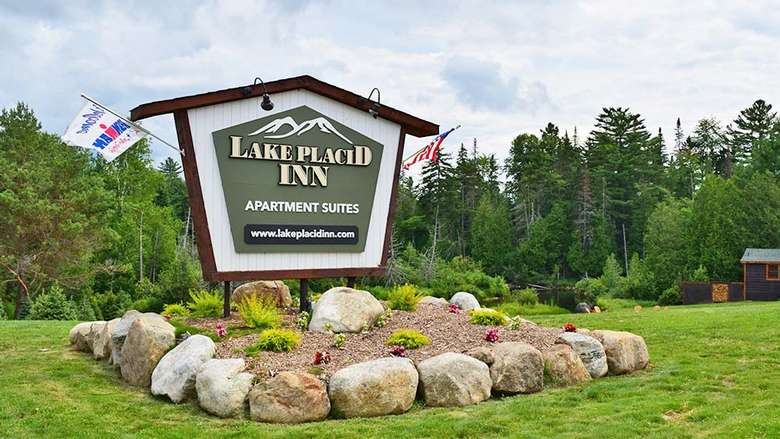 a large sign for the lake placid inn