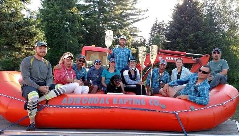 group posing on raft