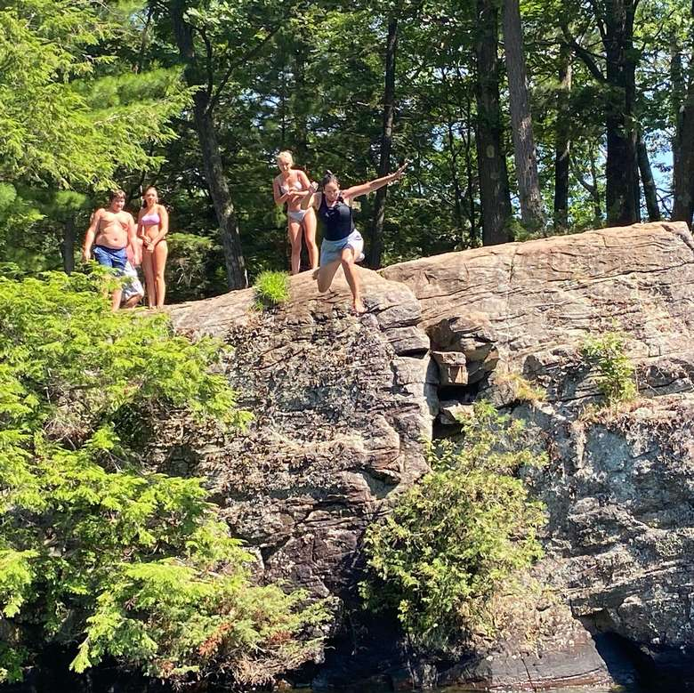 woman cliff jumping