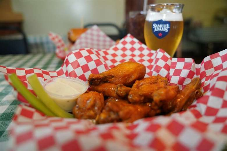 chicken wings and beer glass