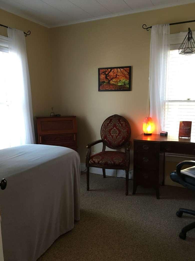a room with a salt lamp on a table