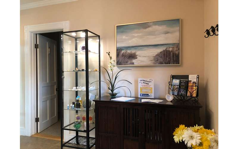 a dark brown cabinet next to a tall display