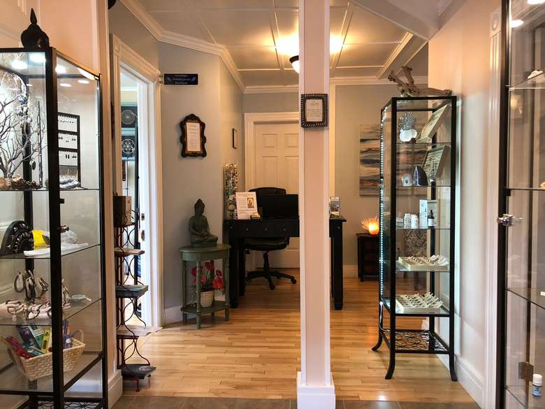 hallway with tall shelves and displays around