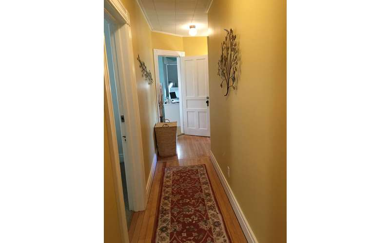 long hallway with carpet
