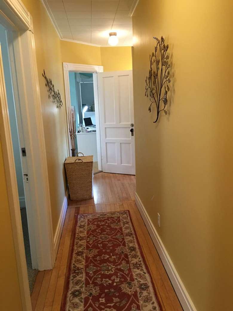 long hallway with carpet
