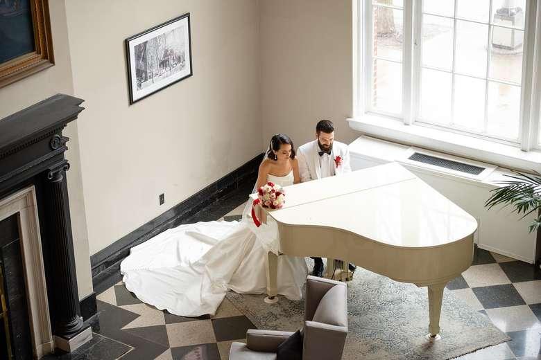 bride and groom at a piano