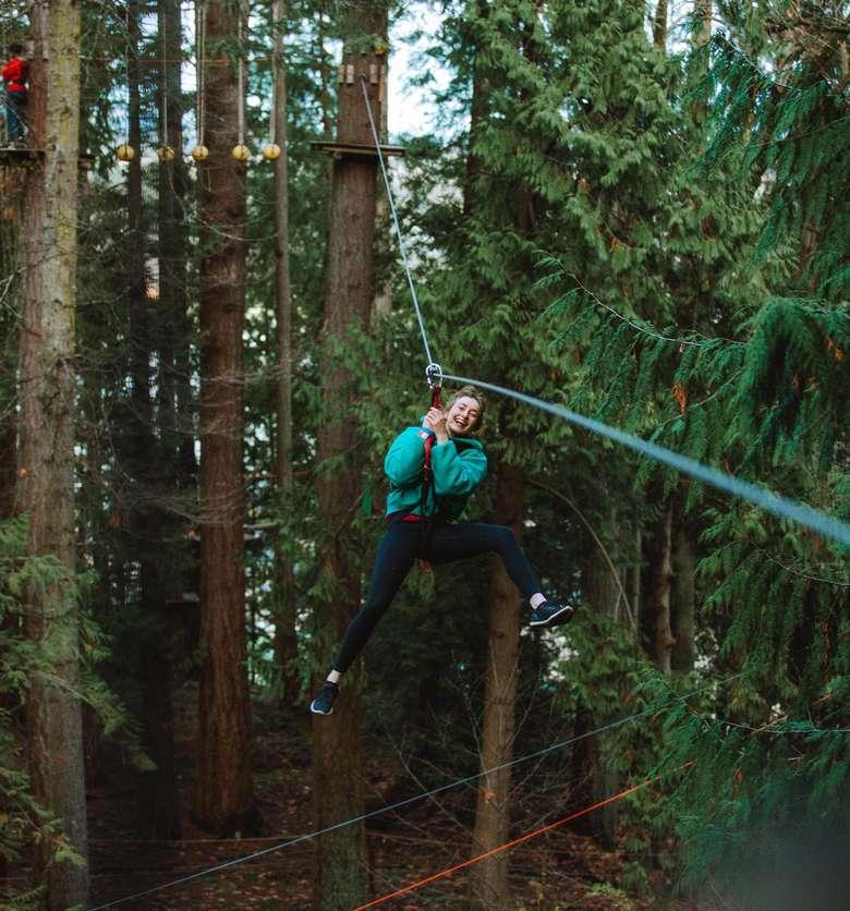 woman riding down a zipline