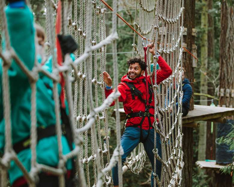 people on treetop net obstacle