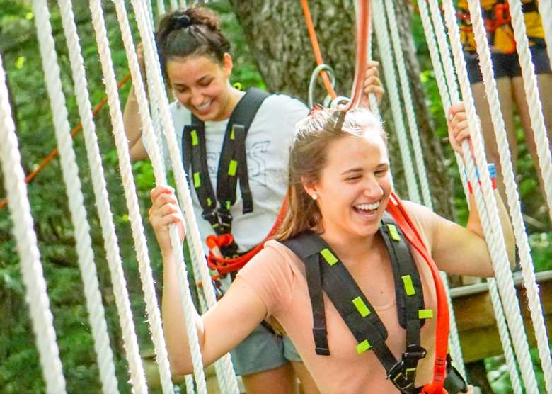 women on treetop course
