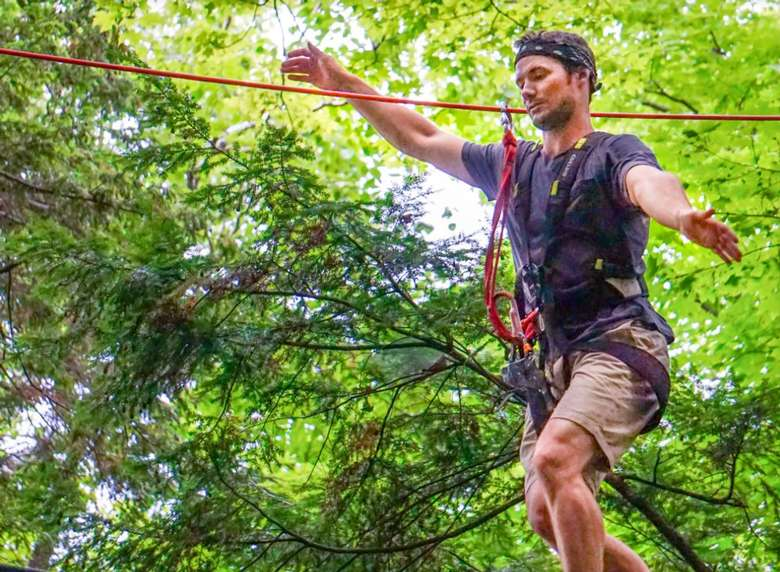 man on treetop course