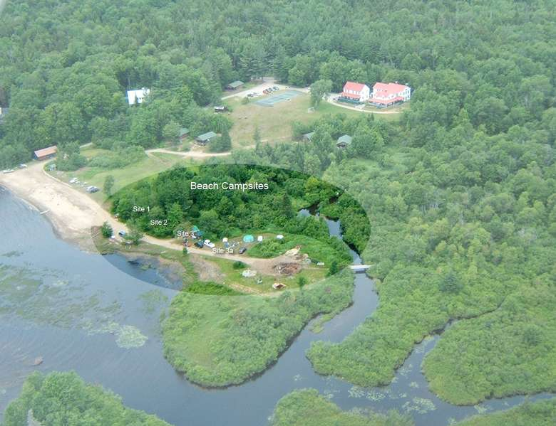 aerial view of beach campsites in woods