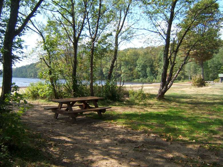 picnic table with lake in the background