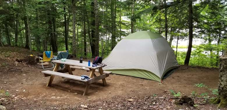 tent set up near picnic table