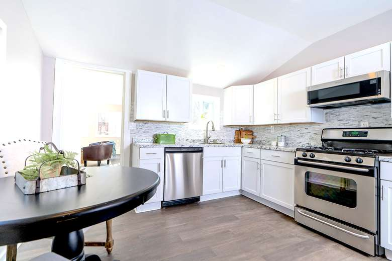 kitchen with cabinets, appliances, and a table