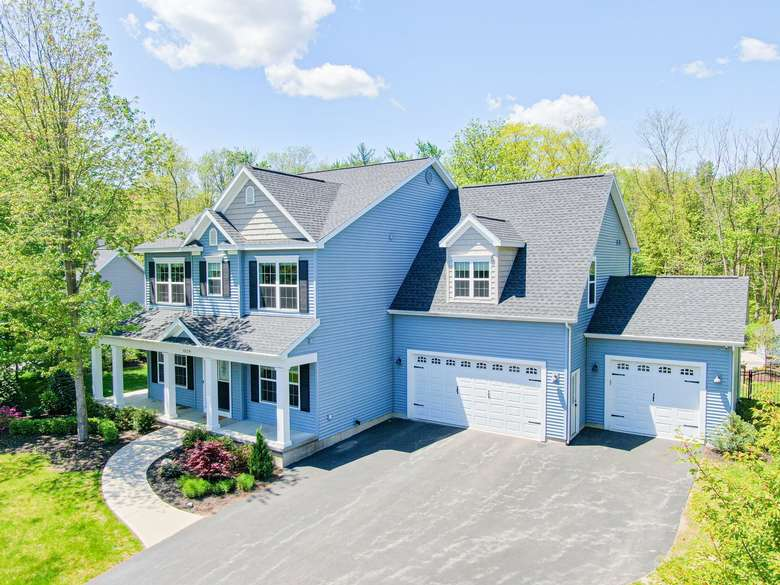 a blue house with two garages