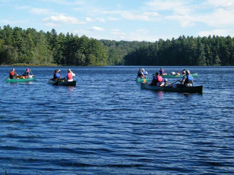 group of people in canoes on a lake