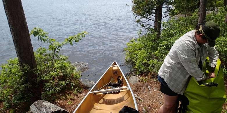 person near a canoe