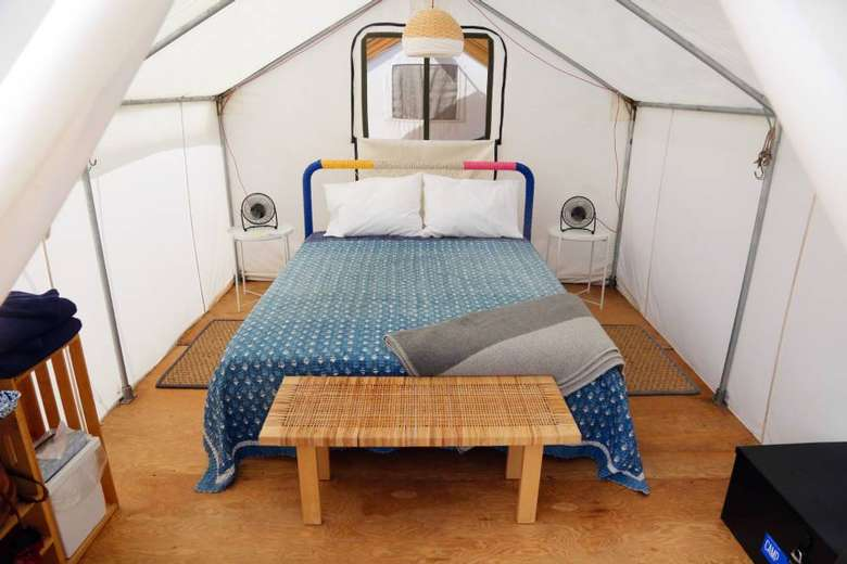 large bed and amenities in a glamping tent