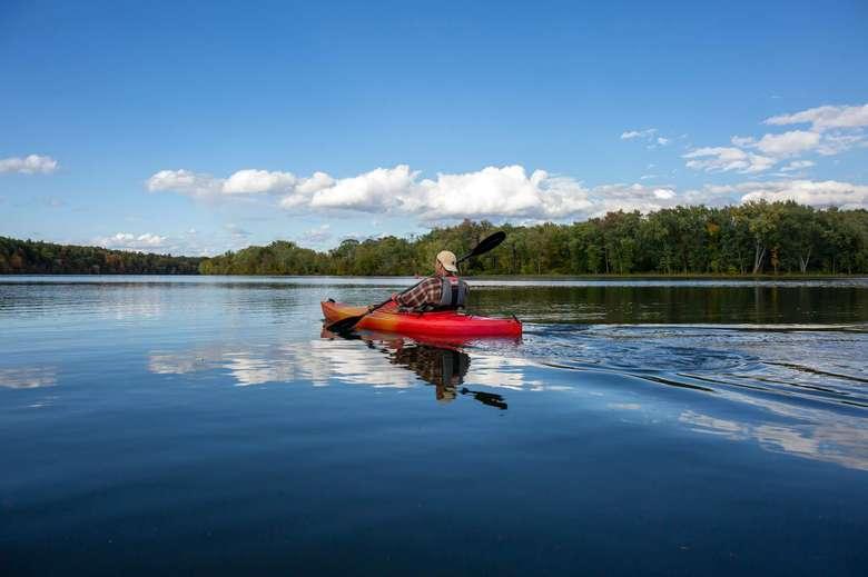 man kayaking on a waterway