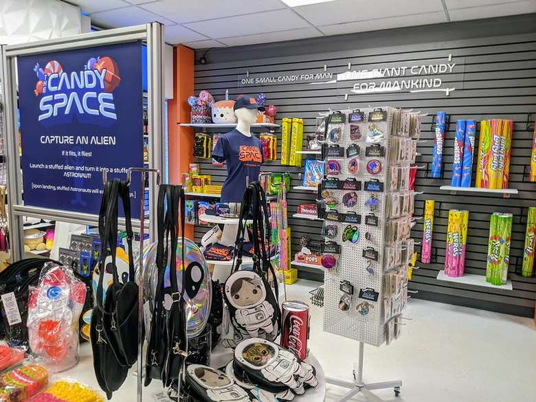 space themed bags and other products in a store