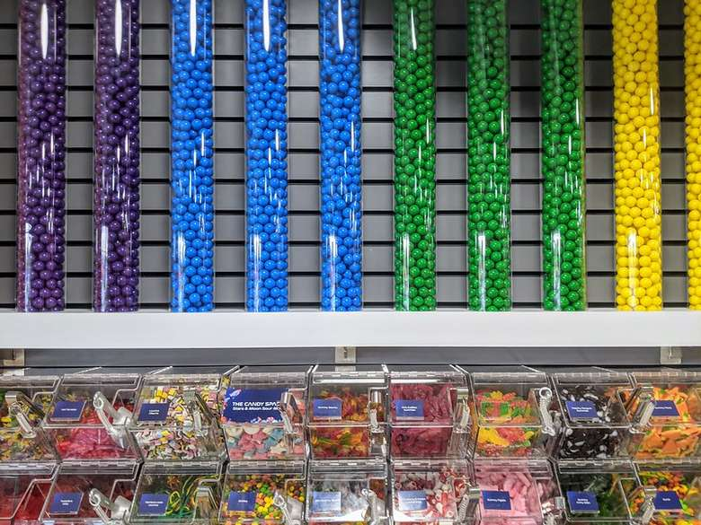 colorful candies on the wall and containers of candy