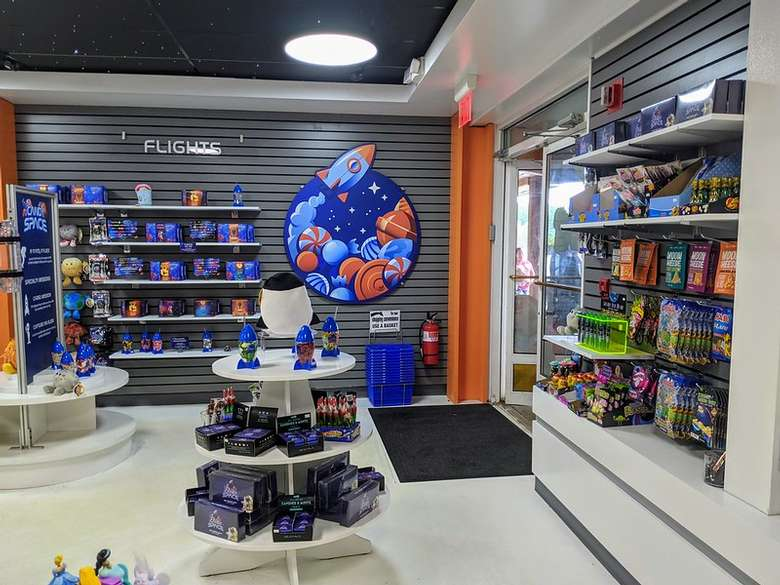candy and goodies on display in a space themed candy store