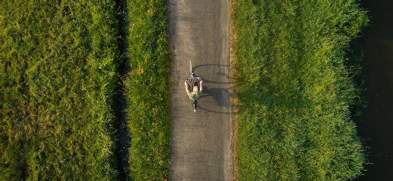 overhead view of a person biking on a paved route