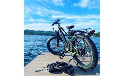 electric bike on a dock by the water