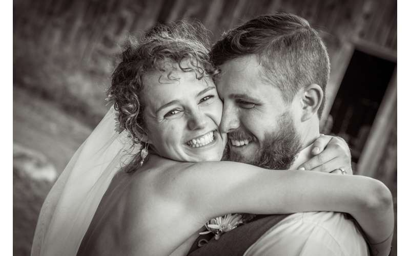 bride and groom embracing and smiling