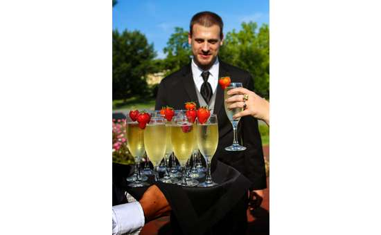 groomsmen with tray of champagne in front of him