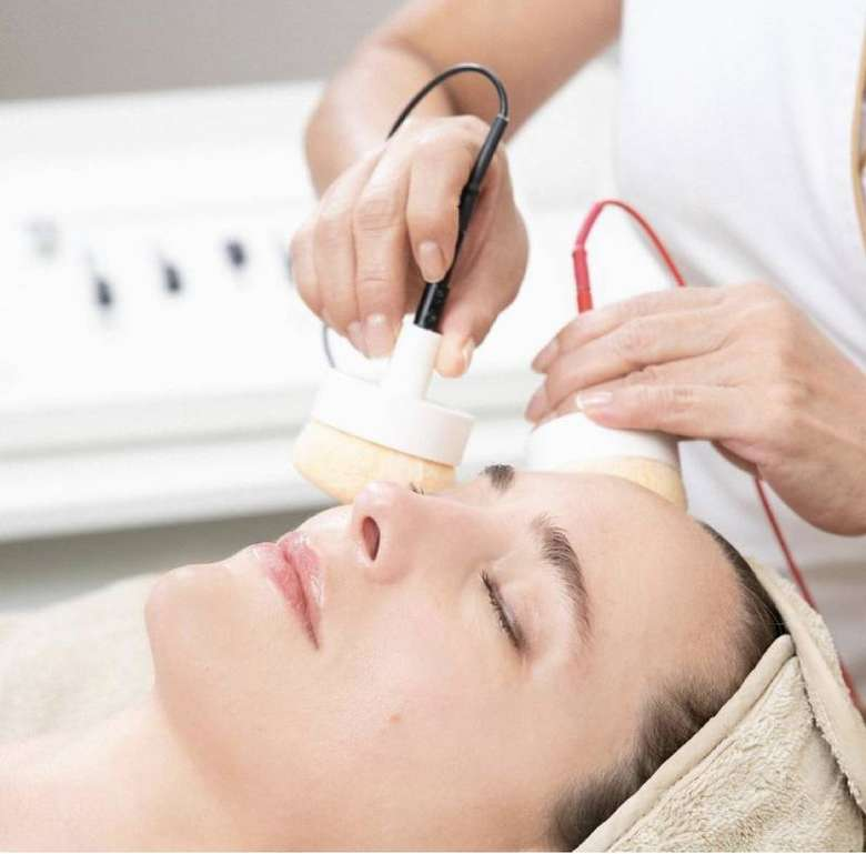 facial equipment being used on woman