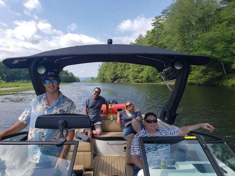 four people on a boat