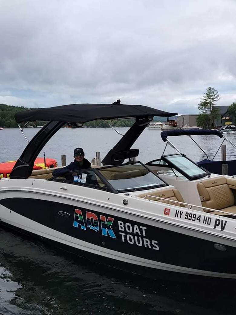 a boat with a logo sticker for adk boat tours