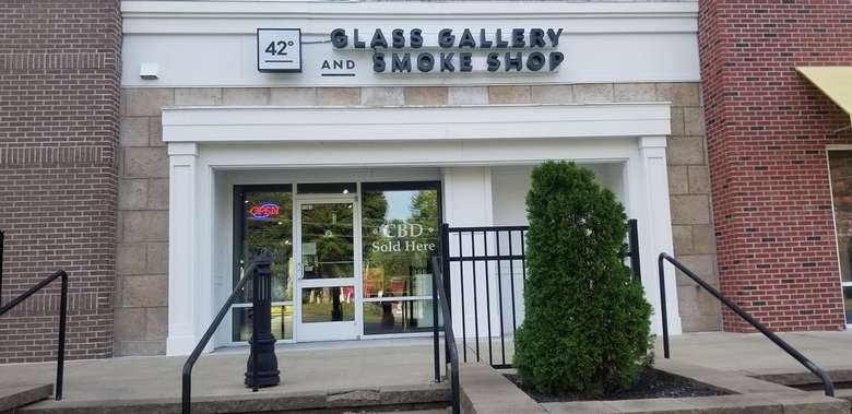outside of a glass gallery and smoke shop