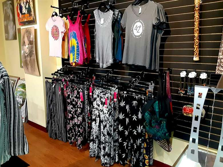 shirts and clothing on display in a store