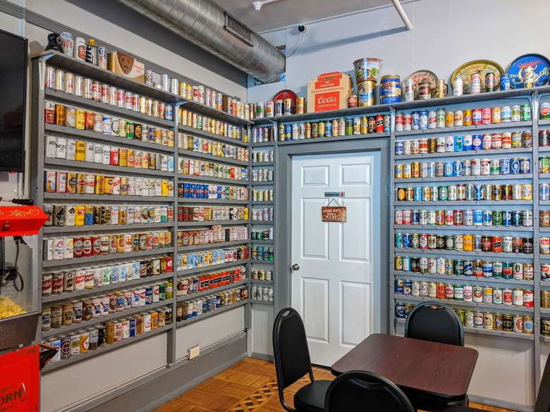 beer cans decorating two walls