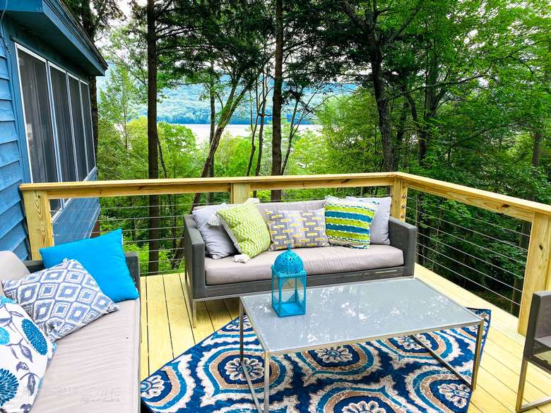 patio furniture on a deck with lake views