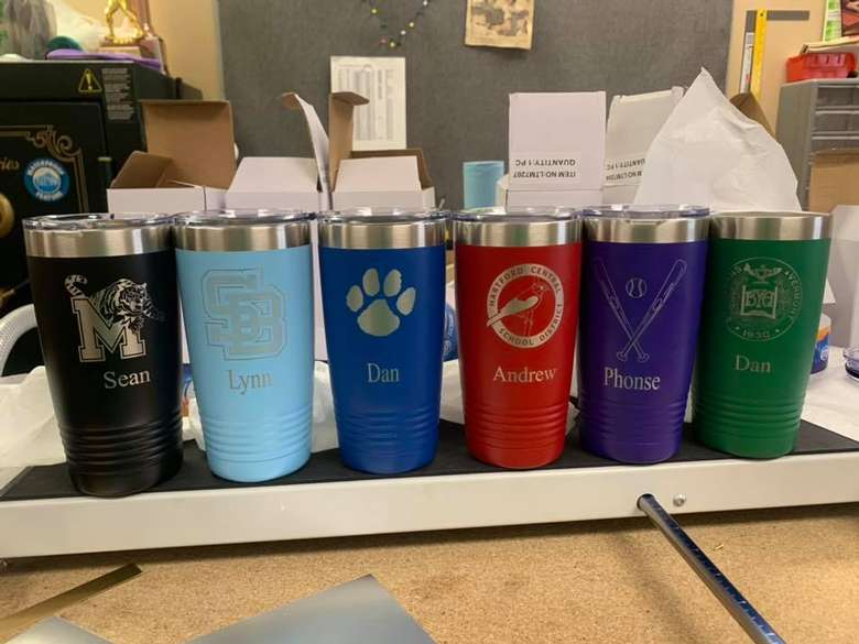 six tumblers with engravings