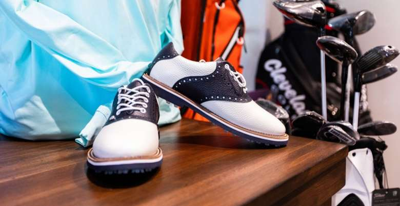 golf shoes and clubs
