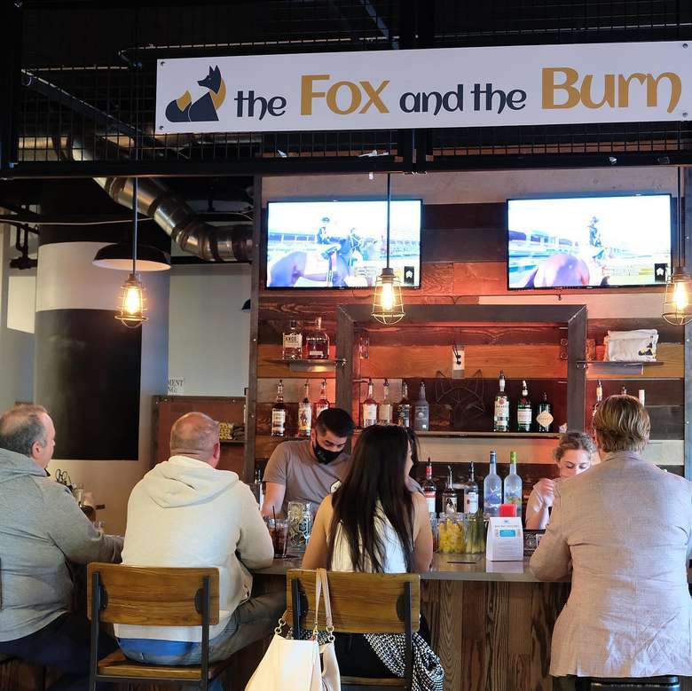 bar and sign that reads the fox and the burn