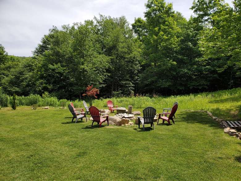 a fire pit and green lawn