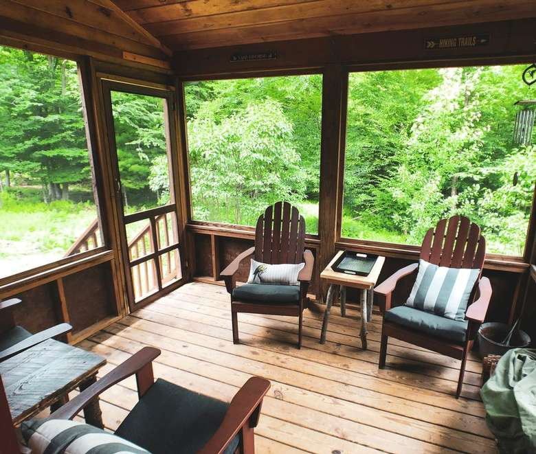 chairs in a screened-in porch