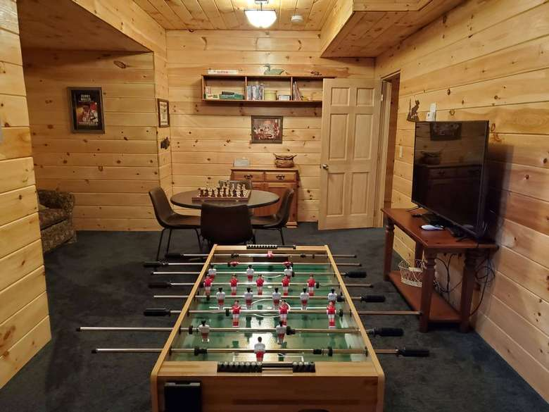 foosball table and other tables in a game room
