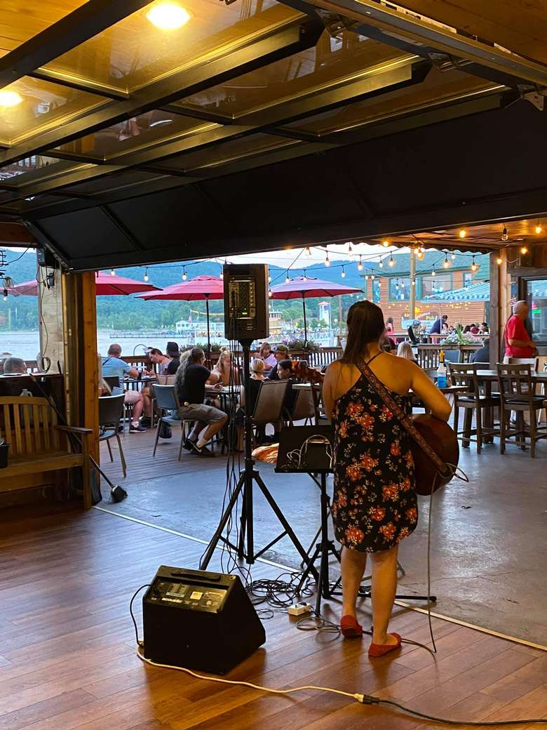 woman playing guitar in a restaurant
